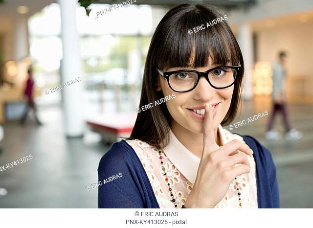 Portrait of a businesswoman with finger on lips