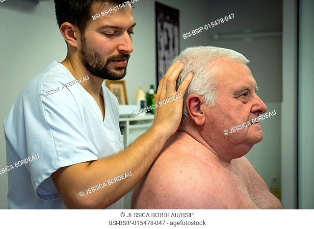 Osteopathy session for a 69-year old man suffering from pain in the lumbar belt and the shoulder girdle