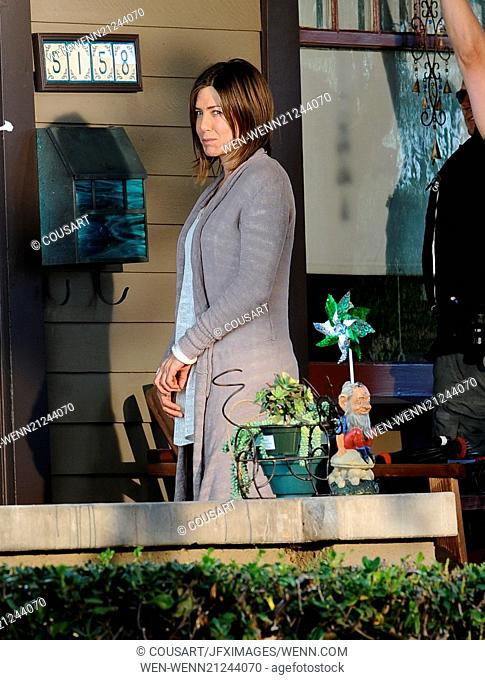 Jennifer Aniston spotted on the set of her new film 'Cake' with severe scars on her face and neck, shooting on location in Los Angeles with co-star Sam...