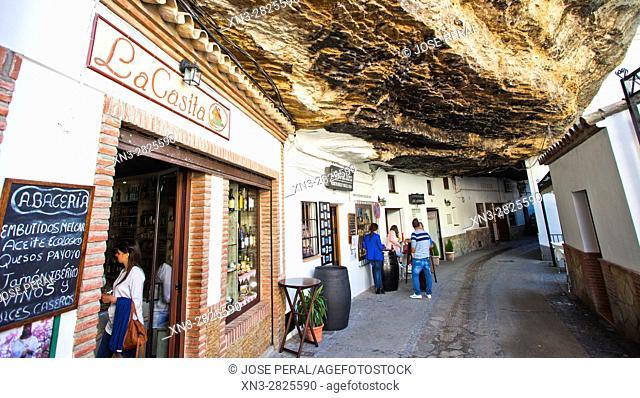Typical terrace restaurants constructed in caves sit under huge rocks, Setenil de las Bodegas, White Towns, Pueblos Blancos, Cadiz province, Andalusia, Spain