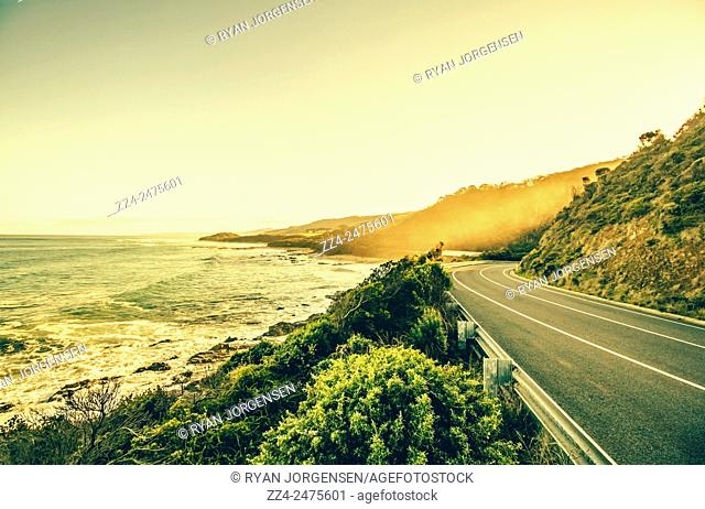Great Ocean Road landscape of a winding road leading around a Victorian coastline. Marengo, Victoria, Australia