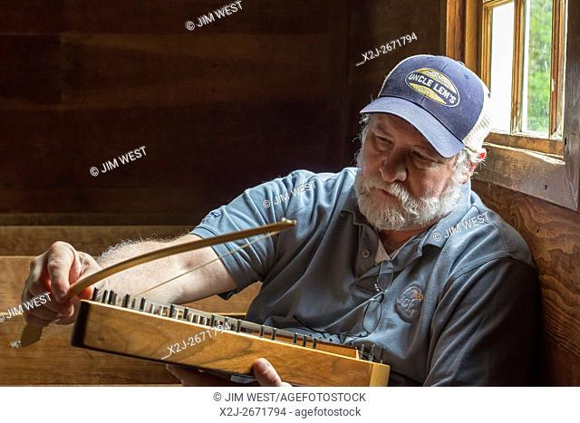 Great Smoky Mountains National Park, Tennessee - Charlie Closz plays his psaltery in Cades Cove Primitive Baptist Church