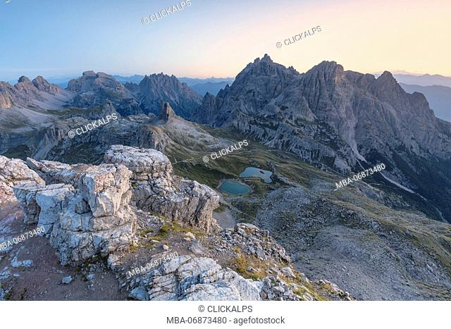 Sunrise from the top of mount Paterno / Paternkofel towards Tre Scarperi group and Laghi dei Piani / Bodenseen, Sexten Dolomites, South Tyrol, Bolzano, Italy