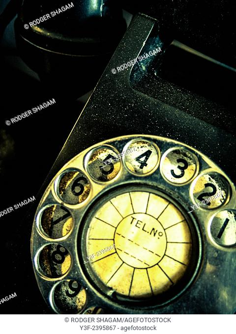 Old telephone with rotating dial with finger holes