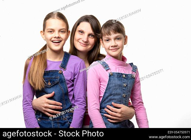 Portrait of a family, mom with two daughters, on a white background