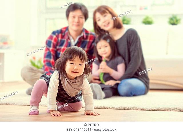 0cdf5639f Young happy family with toddler pretty daughters playing together and  having fun at home
