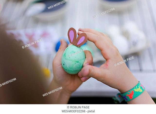 Close-up of girl holding dyed Easter egg