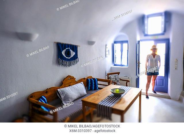 Woman in a house. Pyrgos village. Santorini. Cyclades islands. Greece