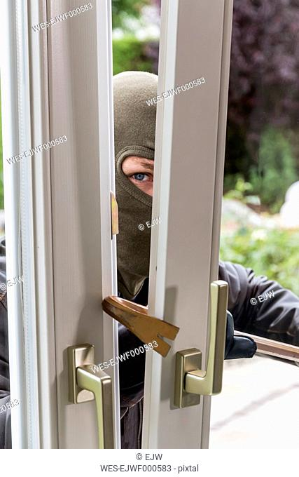 Burglar trying to get into house