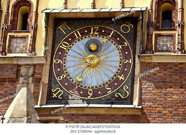 Clock at the town hall facade in Wroclaw, Poland