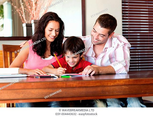 Nice parents helping their son for homework