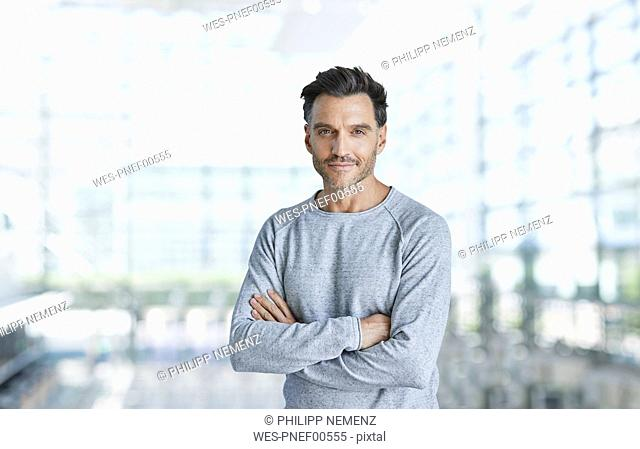 Portrait of content mature man with stubble