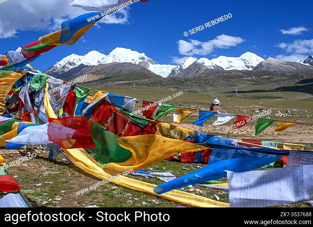 La Ken La pass or Laken pass at 5190 metres on the road to remote Nam Tso Lake Tibet. Namtso Lake Tibet China. Prayer flags next to the base of Mount Nyenchen...