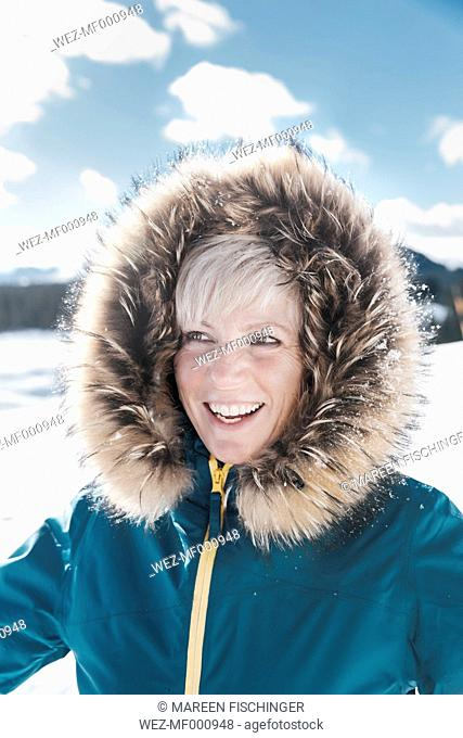 Germany, Bavaria, Winklmoosalm, Portrait of smiling mature woman