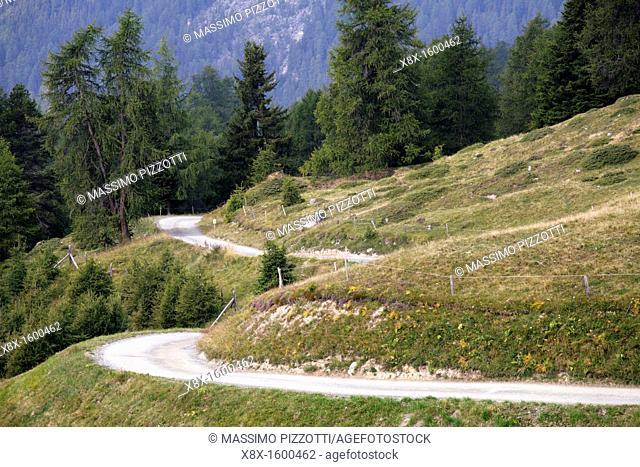 Twisting dirt road on the Swiss Alps, Switzerland
