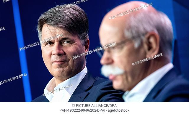 22 February 2019, Berlin: Harald Krüger (l), Chairman of the Board of Management of BMW AG, and Dieter Zetsche, Chairman of the Board of Management of Daimler...