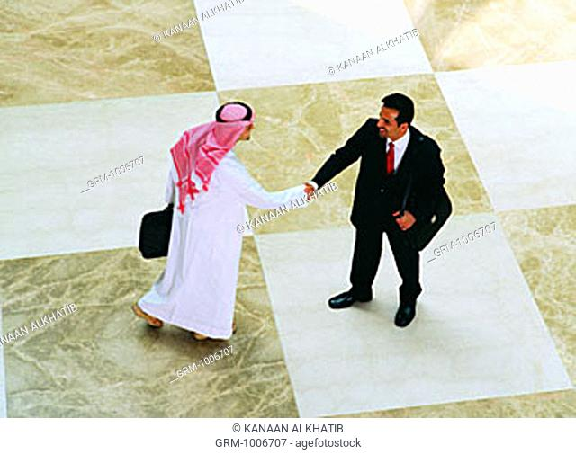Arab businessmen greeting each other