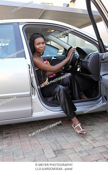 Woman getting out of car, Johannesburg, South Africa