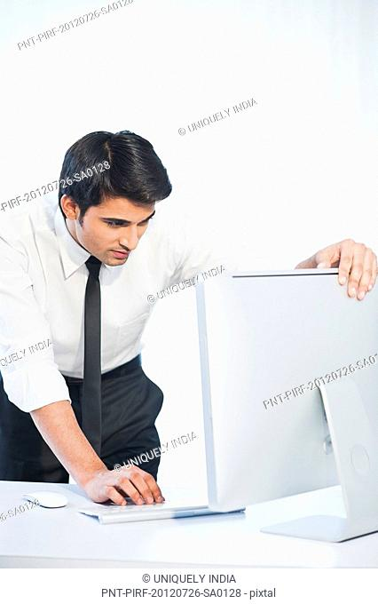 Businessman working on a desktop pc