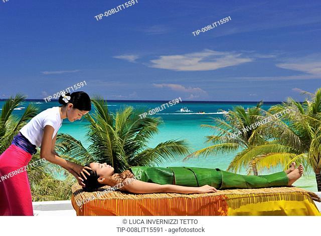Asia, Philippines, Boracay, Mandala spa, woman getting a massage on the beach
