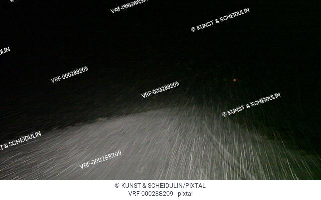 POV-shot of from a car driving through a blizzard at night. Noraström, Västernorrlands Län, Sweden