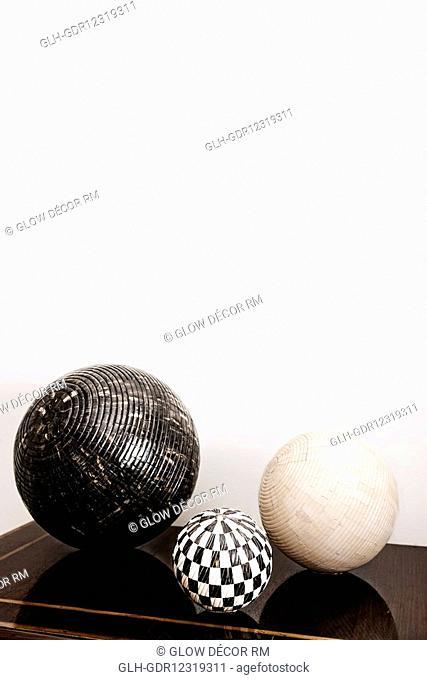 Three decorative balls on a chest