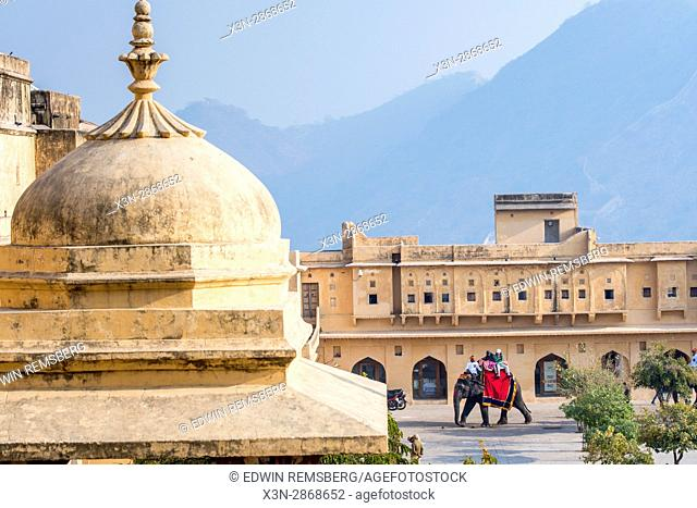 Tourists riding up to Amer Fort on elephants in Jaipur, India