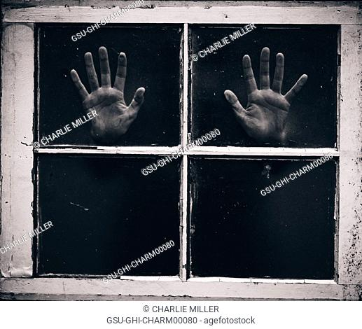 Palms of Hands Pressed Against Window Panes