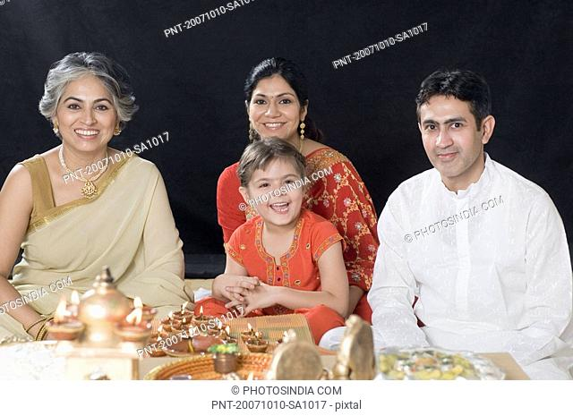 Portrait of a family sitting in deepavali pooja