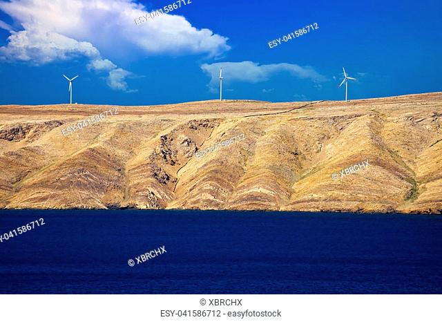 Stone desert island of Pag wind power plants view, archipelago of Croatia