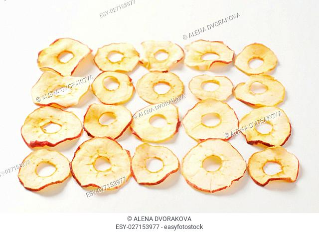dried apple chips ranked on white background