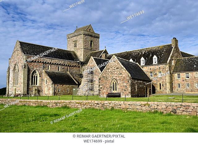 Restoration work of medieval church and monastery of Iona Abbey founded by St Columba on Isle of Iona Inner Hebrides Scotland UK