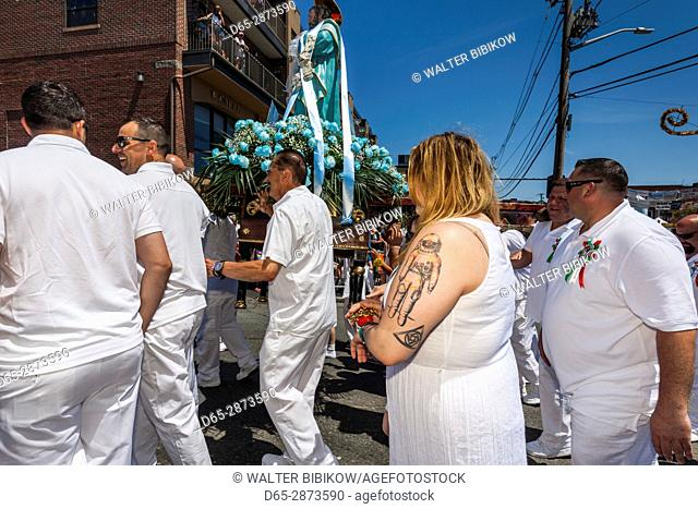 USA, Massachusetts, Cape Ann, Gloucester, St. Peter's Fiesta, Italian-Portuguese fishing community festival, religious procession, woman with astronaut tattoo
