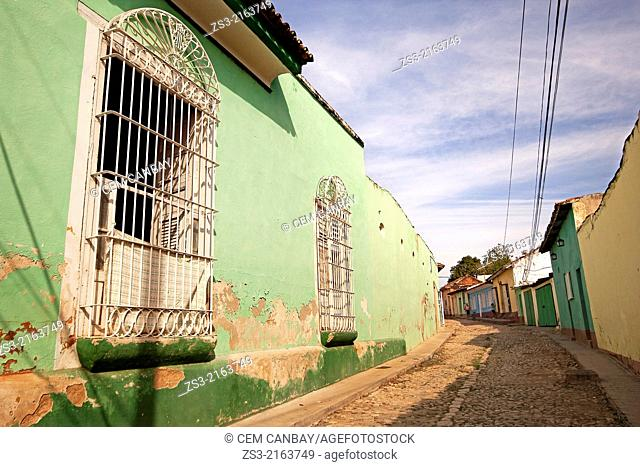 Scene from the cobblestone streets in town center, Trinidad, Sanct' Sp'ritu Province, Cuba, West Indies, Central America