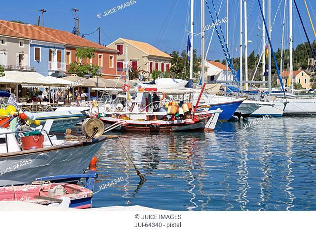 Greece, Kefalonia, Fiskardo, Boats in sunny Harbour