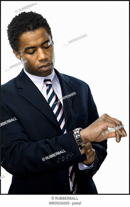 Close-up of a businessman looking at his wrist watch