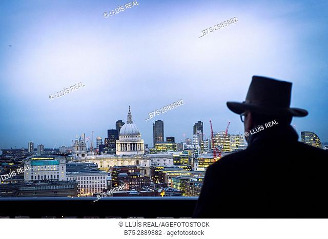 Unrecognizable man looking to the City. Tate Modern, Bankside, London, England