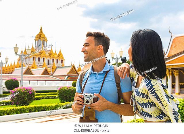 Young tourist couple visiting temple, Bangkok, Thailand