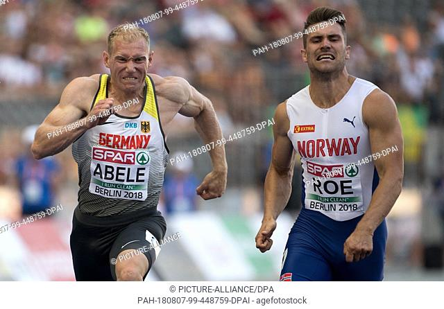 07.08.2018, Berlin: Athletics: European Championship in the Olympic Stadium, Decathlon 100m, Men. Arthur Abele (l) from Germany and Martin Roe from Norway cross...