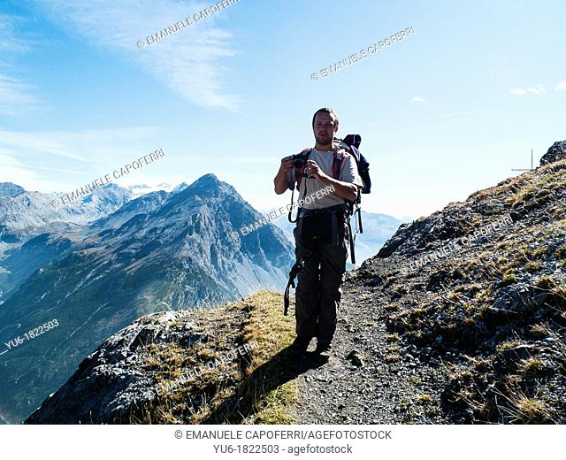 man walking on the trails of Mount Scale, Bormio, Sondrio, Lombardy, Italy