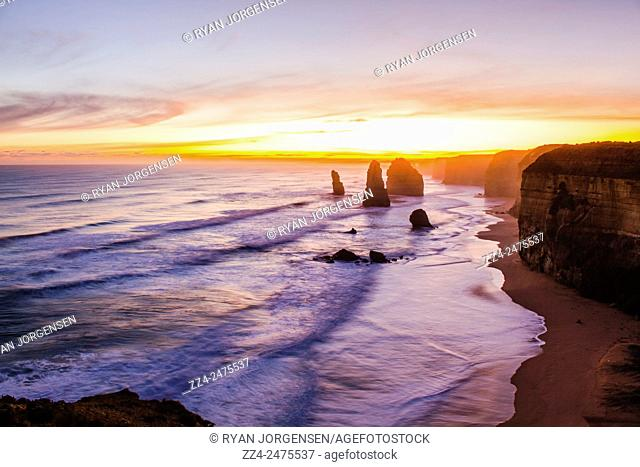 Dramatic sunset view of the famous Twelve Apostles limestone stacks off the shore of Port Campbell National Park on the Great Ocean Road, Victoria, Australia