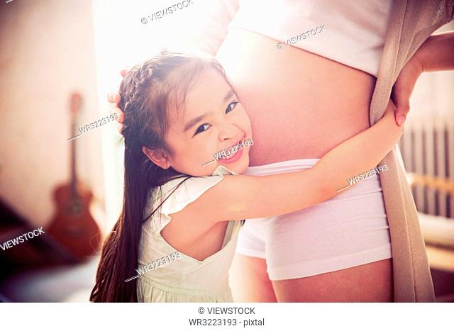 The pregnant mother and the little girl