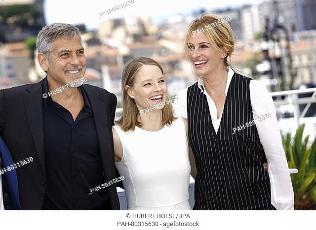 Actors George Clooney (l-r), Jodie Foster and Julia Roberts attend the photocall of Money Monster during the 69th Annual Cannes Film Festival at Palais des...