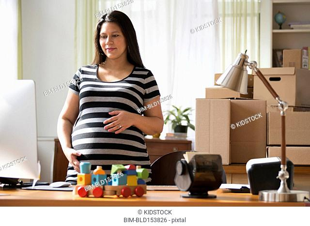 Pregnant businesswoman working from home
