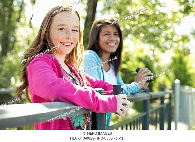female students with binoculars on field trip
