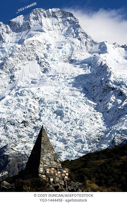 Memorial stone with Mt. Sefton in background, Mount Cook national park, New Zealand