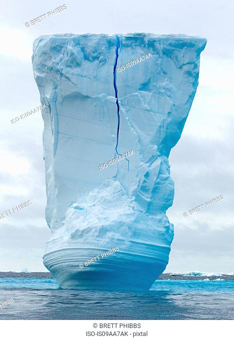 Iceberg amongst the ice floe in the southern ocean, 180 miles north of East Antarctica, Antarctica