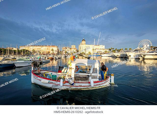 France, Var, Saint Raphael, the old harbor and the Basilica Notre-Dame of Victoire, fisherman and his boat