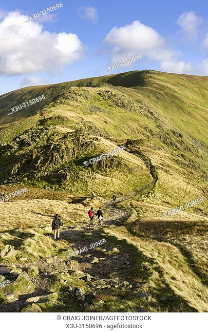 Fell Walkers on the path leading to the summit of Harter Fell from Mardale Ill Bell in the Lake District National Park, Cumbria, England