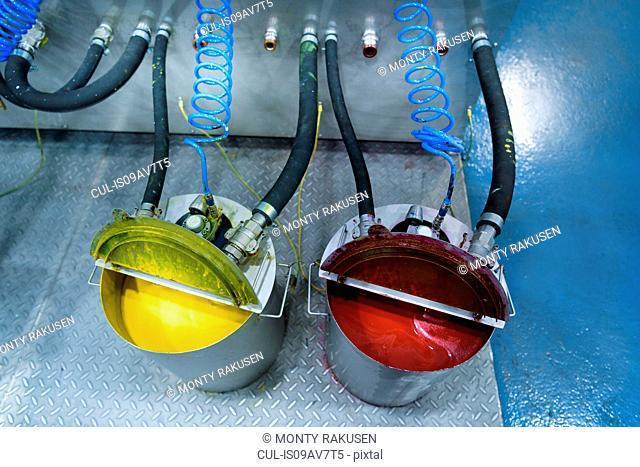 Buckets of ink in food packaging printing factory
